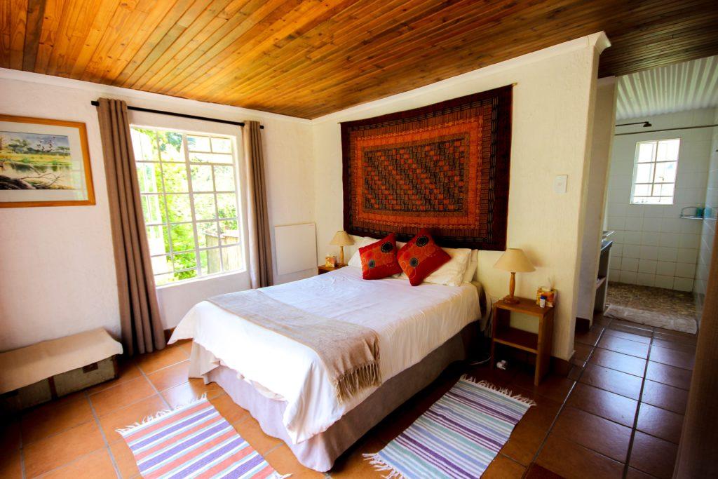 Bedroom in Trogon Cottage
